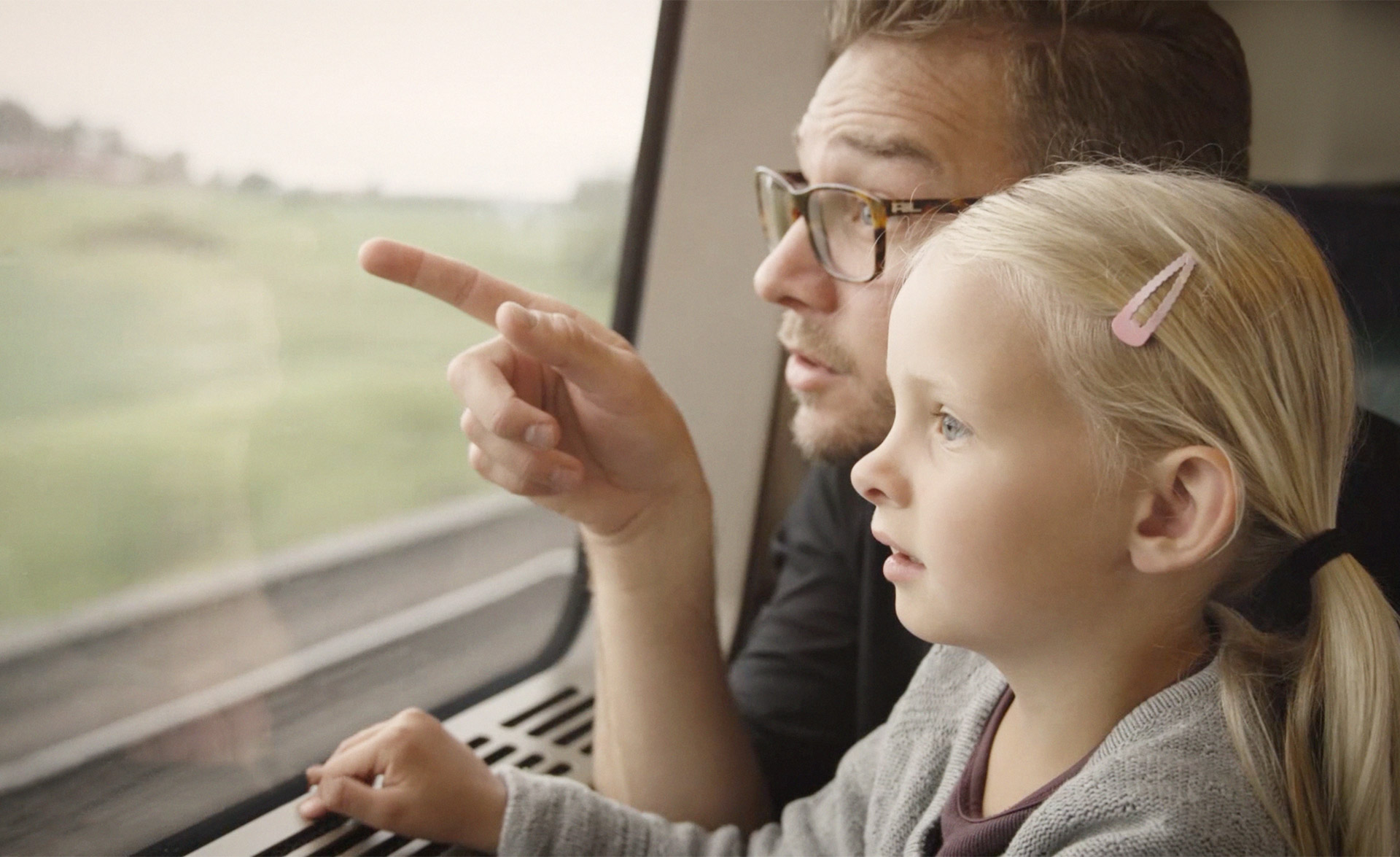 Father and daughter on a train in Sweden
