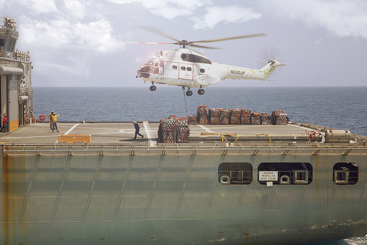 Helicopter landing on a US military boat