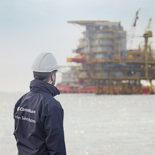 A service engineer from Consilium inspects an oil rig at sea