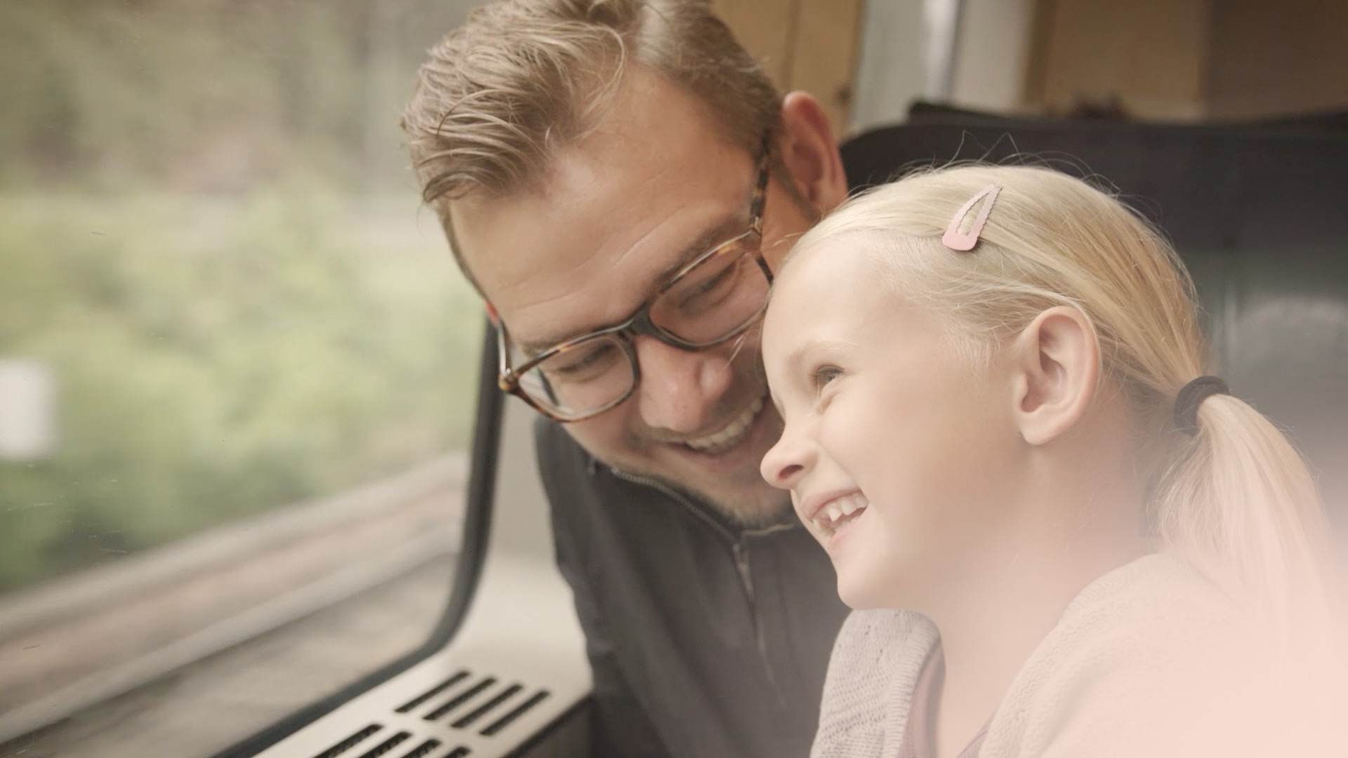 A man and his daughter ride a train and are protected by fire and gas detection from Consilium