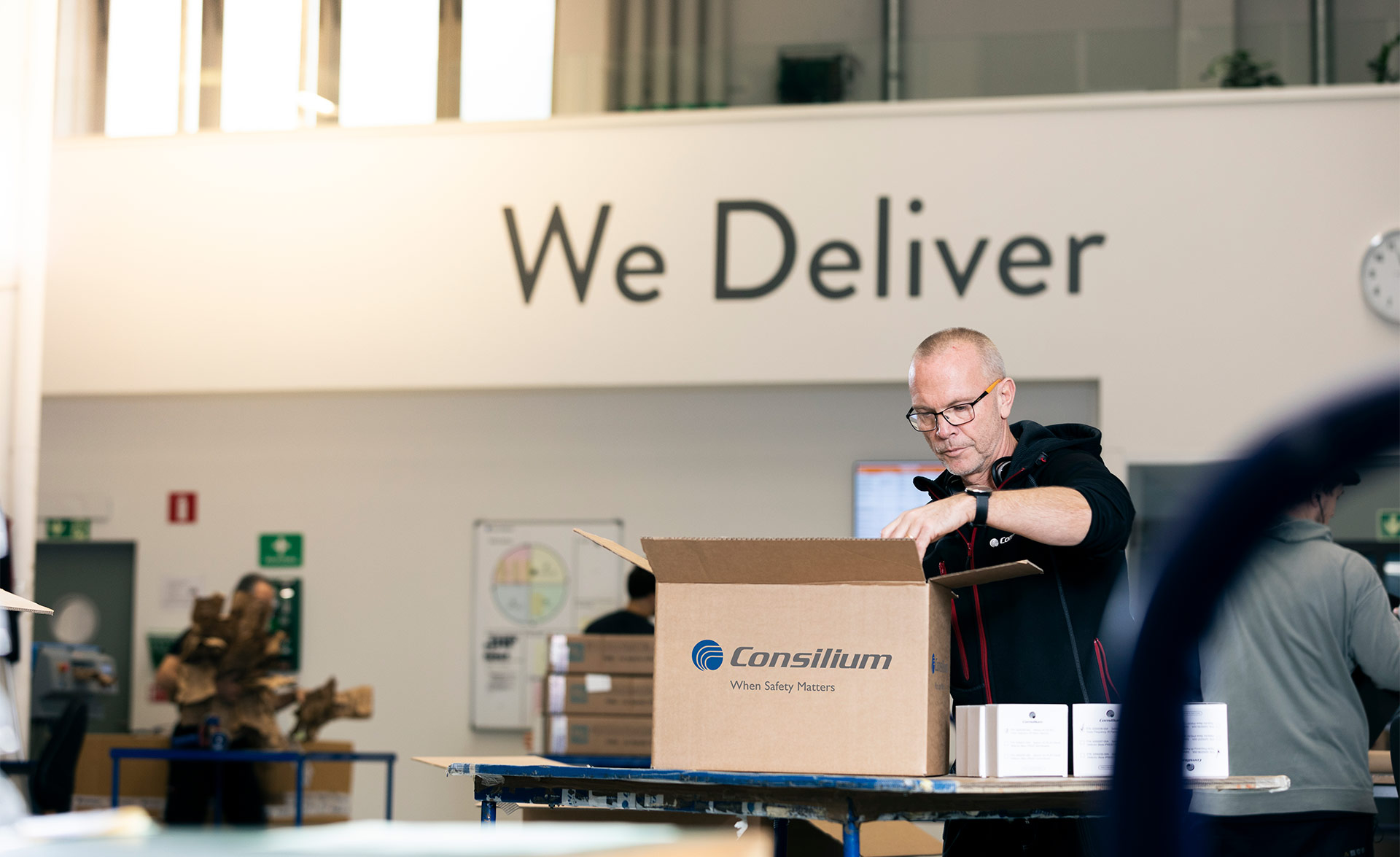 A warehouse worker at Consilium packs parts for fire detection
