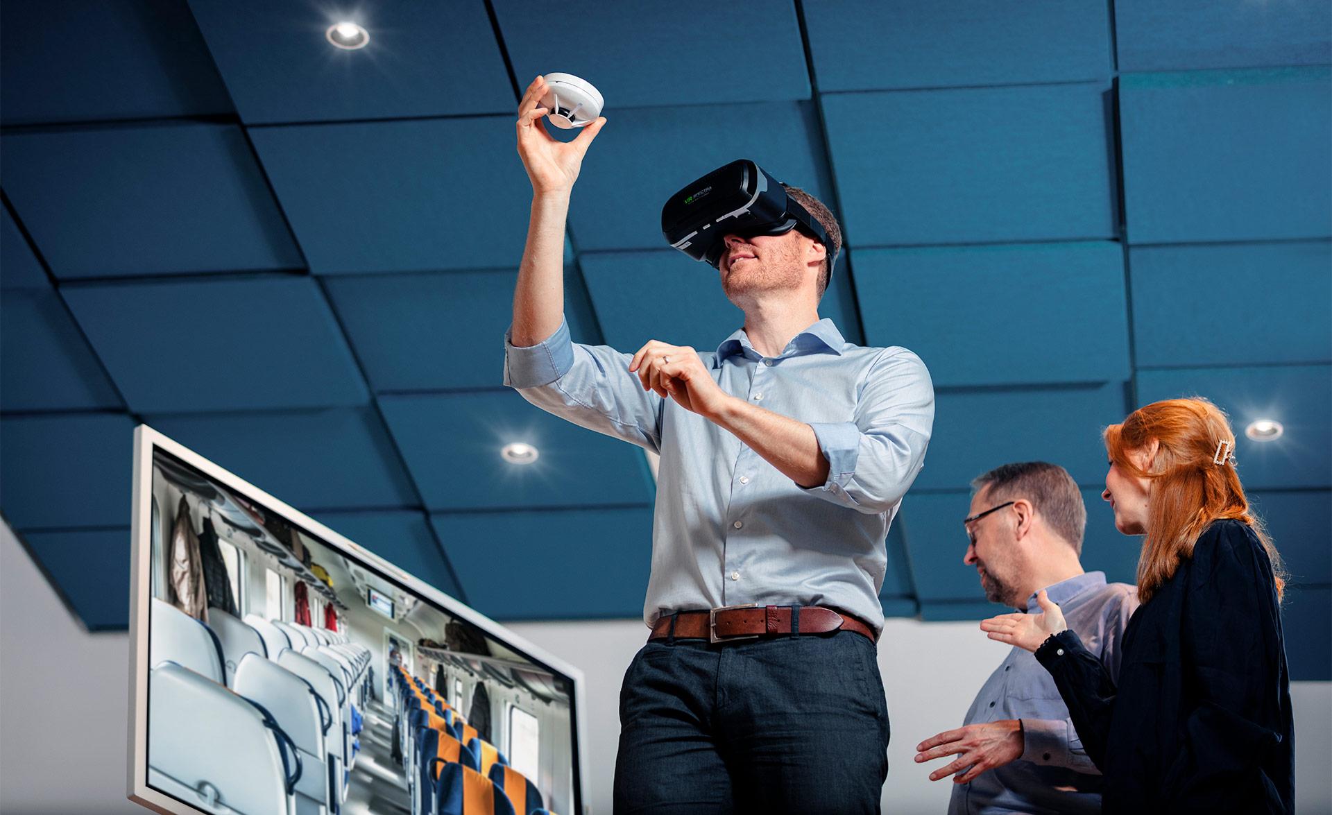 Member of the innovation team trying VR glasses